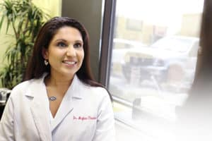 SCNM | Featured faculty in lab coat