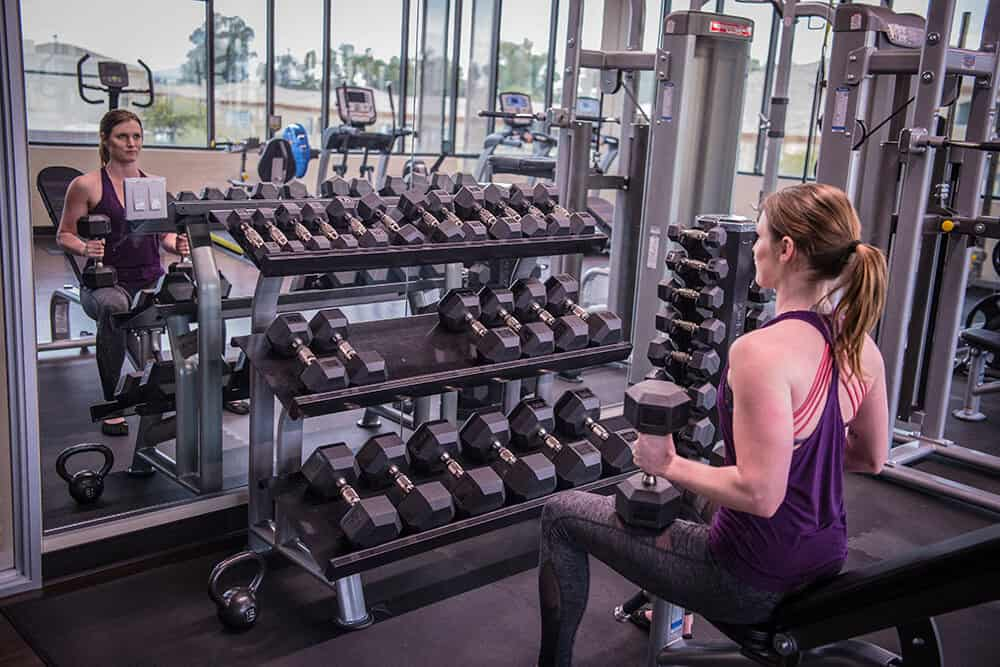 SCNM | women with weights in fitness center