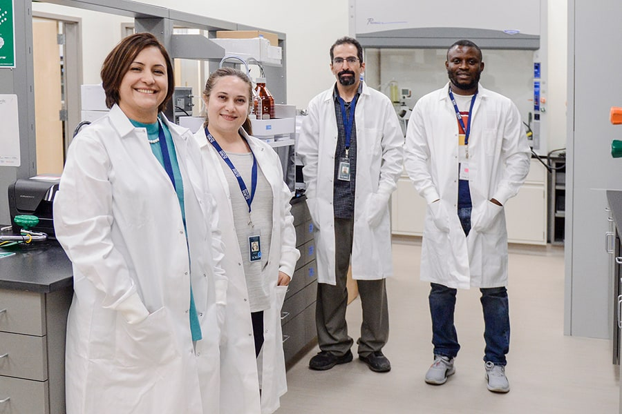 SCNM   Ric Scalzo Team in Lab